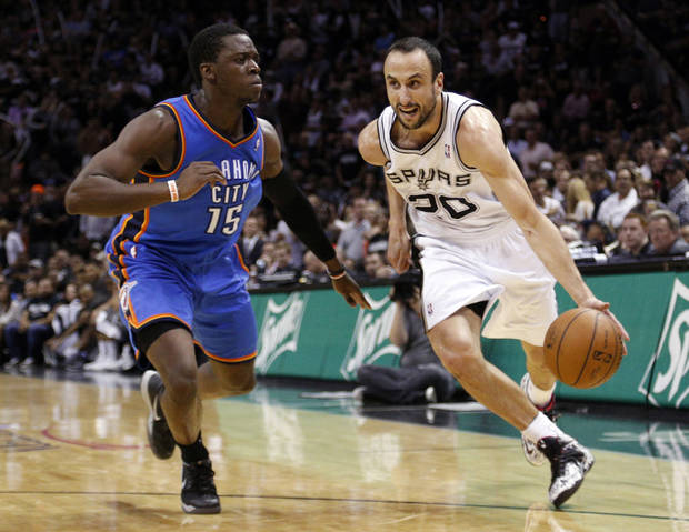 photo - San Antonio's Manu Ginobili (20) gets by Oklahoma City's Reggie Jackson (15) during Game 2 of the Western Conference Finals in the NBA playoffs between the Oklahoma City Thunder and the San Antonio Spurs at the AT&T Center in San Antonio, Wednesday, May 21, 2014. Photo by Sarah Phipps