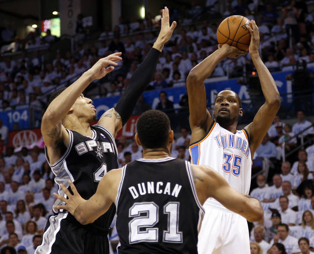 photo - Oklahoma City's Kevin Durant (35) shoots over San Antonio's Danny Green (4) and Tim Duncan (21) during Game 6 of the Western Conference Finals in the NBA playoffs between the Oklahoma City Thunder and the San Antonio Spurs at Chesapeake Energy Arena in Oklahoma City, Saturday, May 31, 2014. Photo by Bryan Terry, The Oklahoman