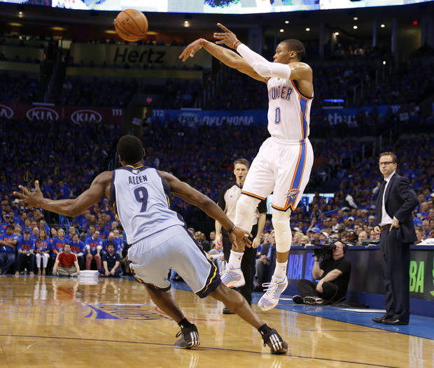 photo - Oklahoma City's Russell Westbrook (0) passes over Memphis' Tony Allen (9) during Game 7 in the first round of the NBA playoffs between the Oklahoma City Thunder and the Memphis Grizzlies at Chesapeake Energy Arena in Oklahoma City, Saturday, May 3, 2014. Photo by Nate Billings, The Oklahoman