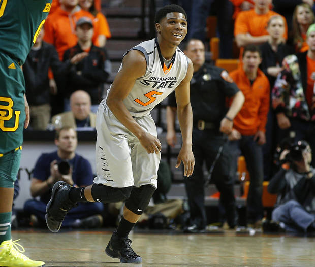 photo - Oklahoma State's Stevie Clark (5) gets up after a play during an NCAA college basketball game between Oklahoma State University (OSU) and Baylor at Gallagher-Iba Arena in Stillwater, Okla., Saturday, Feb. 1, 2014. Baylor won 76-70. Photo by Bryan Terry, The Oklahoman