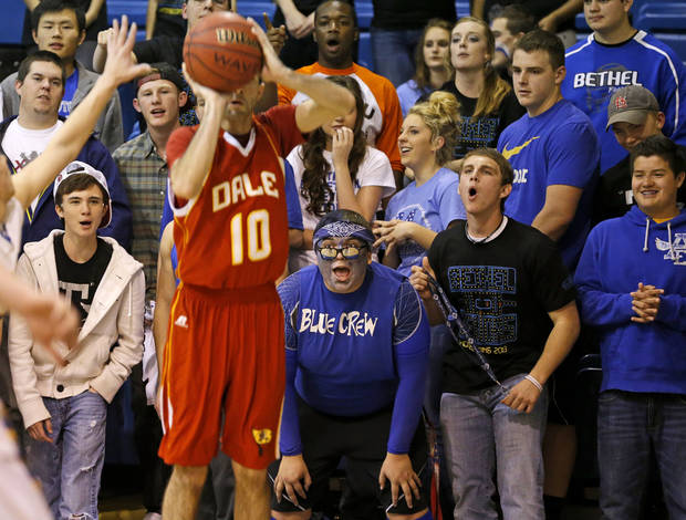 photo - Bethel fans scream as Dale's Jace Wilkins shoots the ball during a boys high school basketball game at Bethel High School in Shawnee, Okla., Friday, Feb. 1, 2013. Photo by Bryan Terry, The Oklahoman