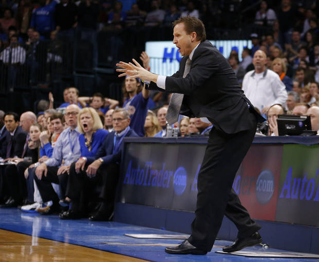 photo - REACTION: Oklahoma City coach Scott Brooks reacts during an NBA basketball game between the Oklahoma City Thunder and the Miami Heat at Chesapeake Energy Arena in Oklahoma City, Thursday, Feb. 15, 2013. Miami won 110-100. Photo by Bryan Terry, The Oklahoman