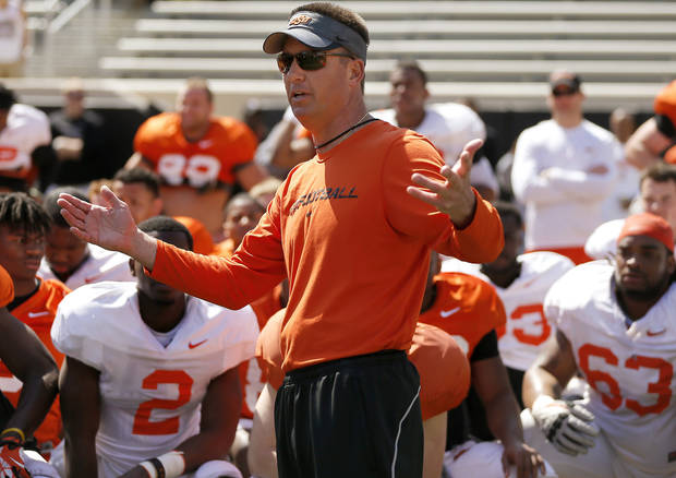 photo - OSU coach Mike Gundy talks with his team after Oklahoma State's Orange Blitz football practice at Boone Pickens Stadium in Stillwater, Okla., Saturday, April 5, 2014. Photo by Bryan Terry, The Oklahoman