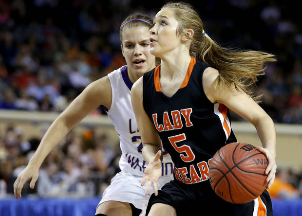 photo - Cheyenne's Morgan Latta goes past Okarche's Morgan Vogt during the Class A girls state championship game between Okarche and Cheyenne/Reydon in the State Fair Arena at State Fair Park in Oklahoma City, Saturday, March 2, 2013. Photo by Bryan Terry, The Oklahoman