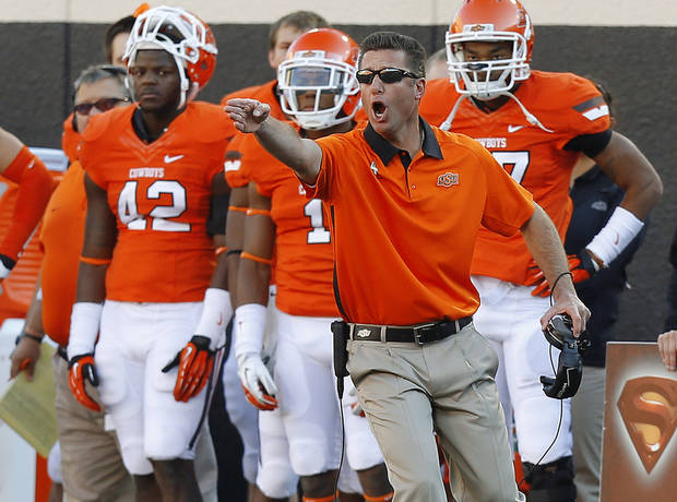 photo - REACTION: OSU coach Mike Gundy reacts during a college football game between Oklahoma State University (OSU) and Texas Tech University (TTU) at Boone Pickens Stadium in Stillwater, Okla., Saturday, Nov. 17, 2012.  Photo by Bryan Terry, The Oklahoman