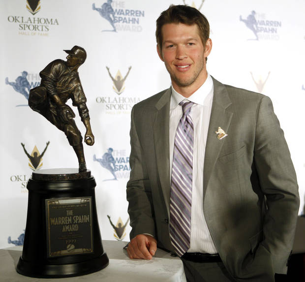 photo - L. A. Dodgers pitcher Clayton Kershaw poses for a photo with the Warren Spahn Award, given to the best left-handed pitcher in Major League Baseball on at the Oklahoma Sports Hall of Fame on Tuesday, Jan. 28, 2014, in Oklahoma City. Photo by KT King, The Oklahoman