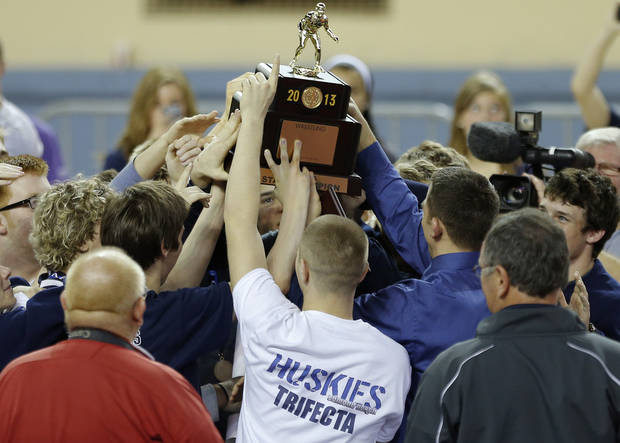 photo - Edmond North celebrates after winning the Class 6A championship in the state wrestling championships at the State Fair Arena in Oklahoma City, Saturday, Feb. 23, 2013. Photo by Bryan Terry, The Oklahoman