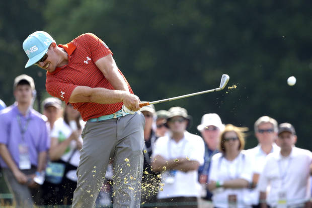 photo - Hunter Mahan tees off on the ninth hole during the third round of the U.S. Open golf tournament at Merion Golf Club, Saturday, June 15, 2013, in Ardmore, Pa. (AP Photo/Gene J. Puskar) ORG XMIT: USO227