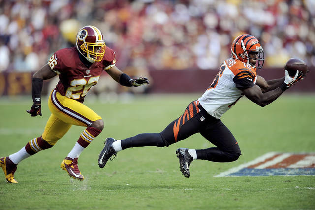 Cincinnati Bengals wide receiver Andrew Hawkins catches a pass while being defended by Josh Wilson of the Washington Redskins during the second half of an NFL football game in Landover, Md., Sunday, Sept. 23, 2012. (AP Photo/Nick Wass)