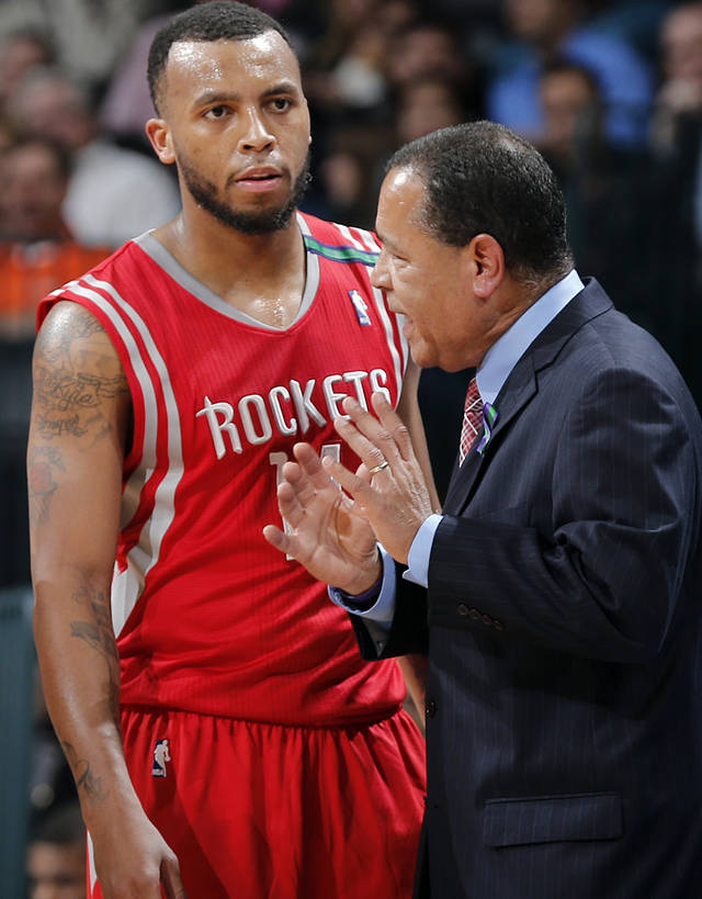 Houston&#039;s Kelvin Sampson talks with Daequan Cook (14) during the NBA basketball game between the Houston Rockets and the Oklahoma City Thunder at the Chesapeake Energy Arena on Wednesday, Nov. 28, 2012, in Oklahoma City, Okla.   Photo by Chris Landsberger, The Oklahoman