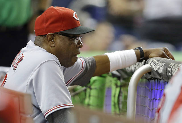 Cincinnati Reds manager Dusty Baker watches from the dugout in the seventh inning during a baseball game against the Miami Marlins, Friday, Sept. 14, 2012, in Miami. The Marlins defeated the Reds 4-0. (AP Photo/Lynne Sladky)
