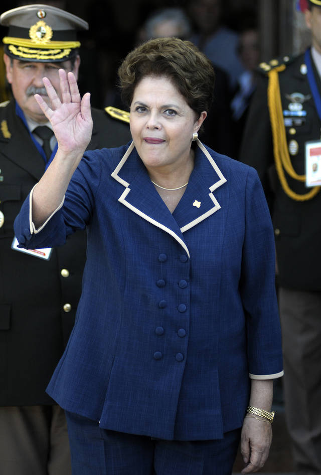 Brazil's President Dilma Rousseff waves before the Mercosur summit in Montevideo, Uruguay,Tuesday, Dec. 20, 2011. Mercosur is a regional trade block formed by Argentina, Uruguay, Paraguay, Brazil. The block has Bolivia, Chile, Colombia, Ecuador, Perú and Venezuela as associated states. (AP Photo/Matilde Campodonico)