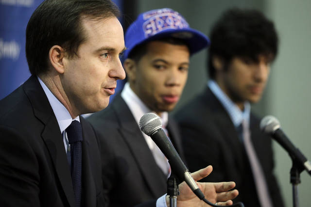 New 76ers general manager Sam Hinkie, left, speaks during a June 28 news conference with newly drafted players Michael Carter-Williams, center, and Arsalan Kazemi. Hinkie has been tight-lipped on the subject of hiring a coach to replace Doug Collins, who resigned in April.AP Photo