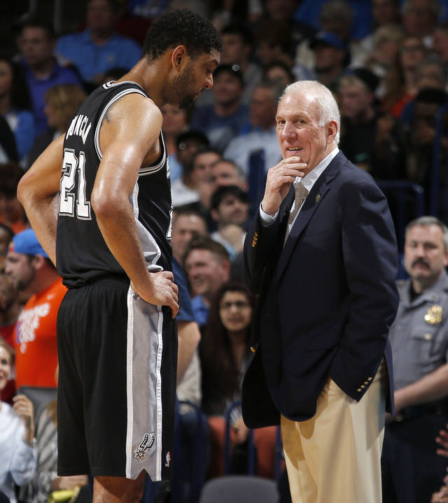 San Antonio coach Gregg Popovich talks with Tim Duncan during an NBA basketball game between the Oklahoma City Thunder and the San Antonio Spurs at Chesapeake Energy Arena in Oklahoma City, Thursday, April 3, 2014. Oklahoma City won 106-94. Photo by Bryan Terry, The Oklahoman