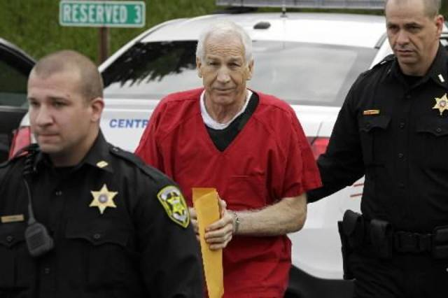 Former Penn State University assistant football coach Jerry Sandusky, center, arrives for sentencing at the Centre County Courthouse in Bellefonte, Pa., Tuesday, Oct. 9, 2012. Tuesday, Oct. 9, 2012. Sandusky was convicted of sexually abusing 10 boys in a scandal that rocked the university and brought down Hall of Fame coach Joe Paterno. (AP Photo/Gene J. Puskar