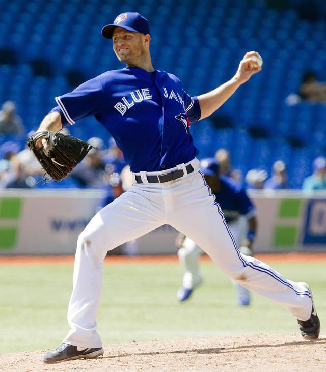 Toronto Blue Jays' J.A Happ works against the Baltimore Orioles during the fifth inning of a baseball game, Monday Sept. 3, 2012, in Toronto. The Orioles won 4-0. (AP Photo/The Canadian Press, Chris Young)