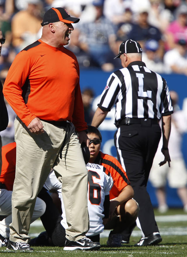 FILE - In this Oct. 22, 2011, file photo, Idaho State coach Mike Kramer yells at an official after one of his players was hurt during during the first half of an NCAA college football game against BYU in Provo, Utah. Kramer is being investigated by police and the university following an Oct. 3 incident where he's accused of shoving a player to the ground. (AP Photo/George Frey, File)