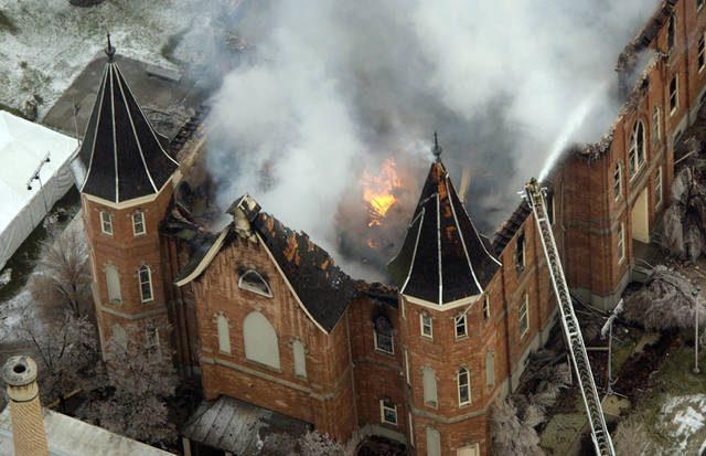 FILE - In this Dec. 17, 2010 file photo the LDS Provo Tabernacle burns as fire fighters try and knock down the flames in Provo, Utah. The Mormon church will build five temples in cities worldwide, including the restoration of this historic church building in Utah that was destroyed in a fire last year, the faith's president said Saturday Oct. 1, 2011. (AP Photo/The Deseret News, Jeffrey D. Allred, File) SALT LAKE TRIBUNE OUT; PROVO DAILY HERALD OUT; MAGS OUT