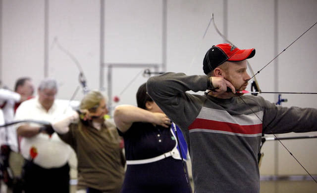 Rob Stillwagon of Oklahoma City shoots during the Oklahoma State Indoor Archery Championship part of the Bart and Nadia Sports and Health Festival, at the Cox Convention Center in Oklahoma City, Sunday, Feb. 12, 2012. Photo by Sarah Phipps, The Oklahoman