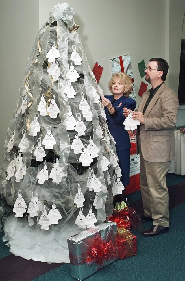 Angel Tree Program at Bethany First Church of the Nazarene. L-R are Judy Mills,  Angel Tree chairperson at the church and Mark Wallace, director prison fellowship ministry.
