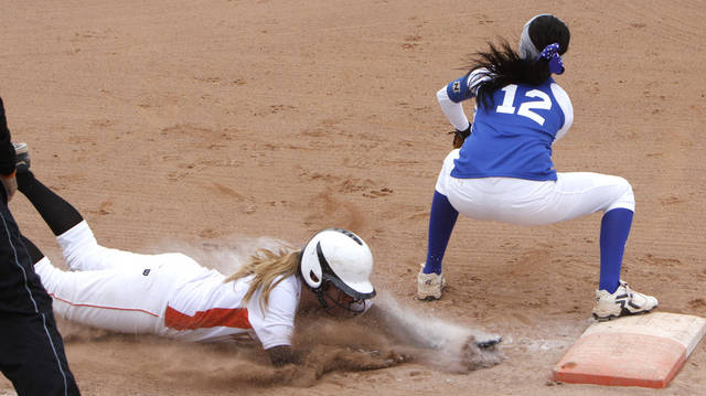 Wayne's Chloe Clifton, left, is put out at first base by Cyril's Chandler Pinkley during Friday's game at ASA Hall of Fame Stadium.  Photo By Paul Hellstern, The Oklahoman