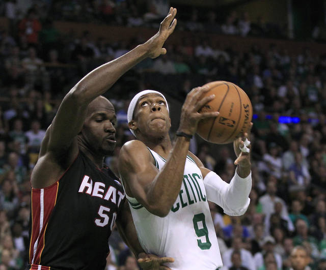 Boston Celtics guard Rajon Rondo (9) looks to shoot past Miami Heat center Joel Anthony (50) during the first quarter of Game 3 in of the NBA basketball playoffs Eastern Conference finals in Boston on Friday, June 1, 2012. (AP Photo/Elise Amendola)