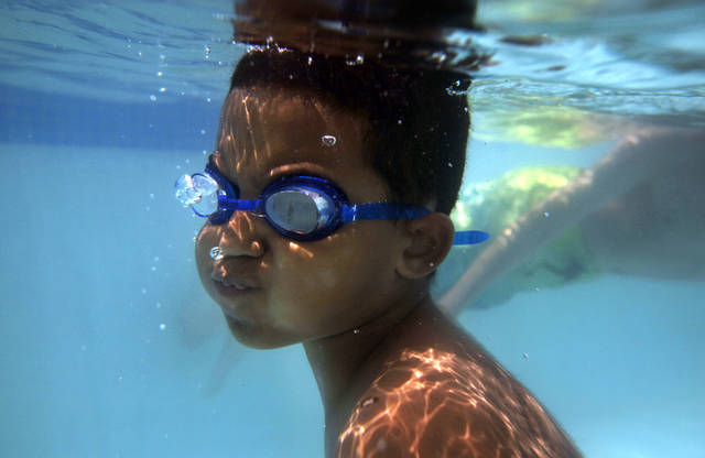 Ibrahim Nieves, 9, swims during the opening weekend of Pelican Bay Aquatic Center in Edmond, Okla.,  Saturday, May 26, 2012. Photo by Sarah Phipps, The Oklahoman.