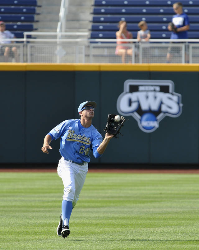 UCLA's Brian Carroll catches a ball during team practice at TD Ameritrade Park in Omaha, Neb., Thursday, June 14, 2012. UCLA will play against Stony Brook on Friday in the opening game of the NCAA baseball College World Series. (AP Photo/Dave Weaver)