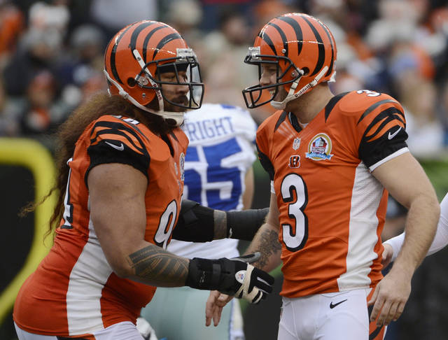 Cincinnati Bengals kicker Josh Brown (3) is congratulated by Domata Peko after Brown kicked a field goal against the Dallas Cowboys in the second half of an NFL football game, Sunday, Dec. 9, 2012, in Cincinnati. Brown kicked four field goals in the game won by Dallas 20-19. (AP Photo/Michael Keating)