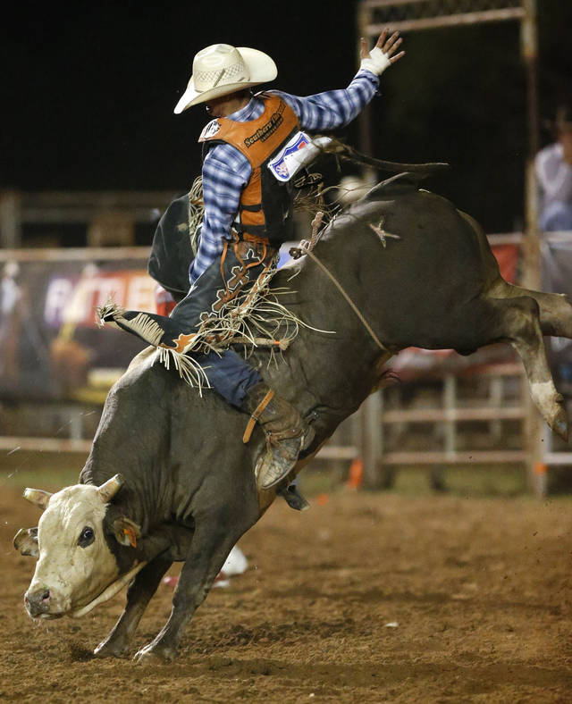 Joseph McConnell of Farmington, New Mexico, competes in bull riding during the International Finals Youth Rodeo in Shawnee on Friday. Photo by Bryan Terry, The Oklahoman