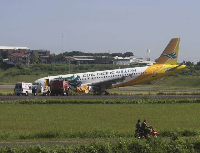 A Cebu Pacific Airbus A320 passenger plane sits on the side of a runway Monday, June 3, 2013 after it overshot the runway upon landing at Davao International Airport in southern Philippines on Saturday evening. No one from 161 passengers and crew were injured but the accident forced the temporary closure of the airport and affected about 80 flights. (AP Photo/Karlos Manlupig)
