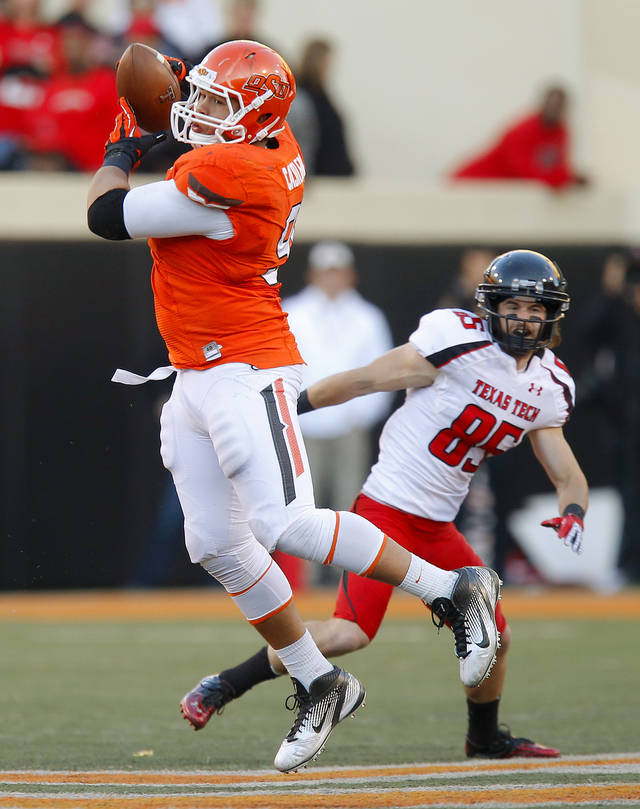 Oklahoma State's James Castleman (91) intercepts a pass as Texas Tech's Jordan Davis (85) watches during a college football game between Oklahoma State University (OSU) and Texas Tech University (TTU) at Boone Pickens Stadium in Stillwater, Okla., Saturday, Nov. 17, 2012.  Photo by Bryan Terry, The Oklahoman