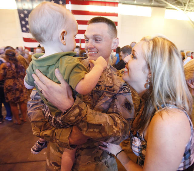 Shelly Mantooth and 18-month-old Collin greet husband and father Spc. Jason Mantooth as Oklahoma National Guard soldiers return from Afghanistan to a welcome home ceremony in Oklahoma City, OK, Tuesday, March 13, 2012,  By Paul Hellstern, The Oklahoman