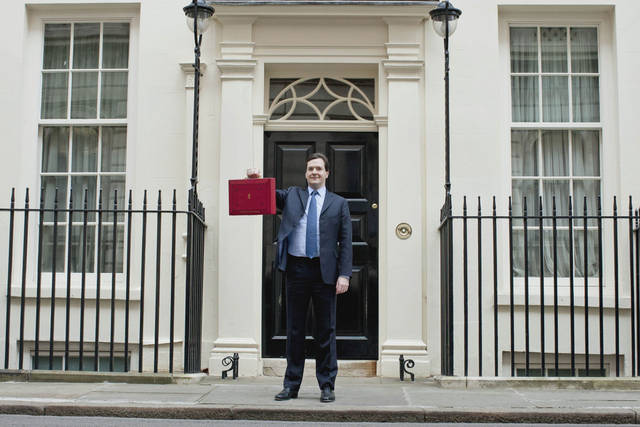 Britain's Chancellor of the Exchequer George Osborne holds up his traditional red dispatch box as he poses for the media outside his official residence at No 11 Downing Street in London, prior to his annual budget speech to the House of Commons, Wednesday, March 21, 2012. Britain's finance minister was expected to announce tax breaks for both the top and the bottom of the nation's income scale Wednesday in his annual budget, but his room for maneuver was limited by the government's drive to slash borrowing and protect its AAA credit rating. (AP Photo/Matt Dunham)