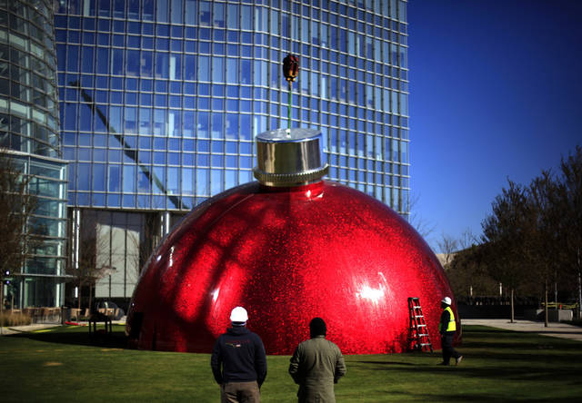 Workers install a large Christmas decoration in front of the Devon Towerr, Tuesday, November 13, 2012 in Oklahoma City. Photo by Sarah Phipps, The Oklahoman
