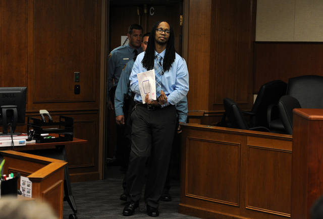 Nathan Dunlap, 38, appears for a hearing at Arapahoe County Court in Centennial, Colo, Wednesday, May 1, 2013. Dunlap's attorneys asked a judge Wednesday to delay designating a week for execution, saying Dunlap's death sentence was meant to be served only after he completed a 75-year sentence for robbery. Dunlap is convicted of killing four people at a Colorado pizza restaurant in 1993. (AP Photo/The Denver Post, Helen H. Richardson, Pool)