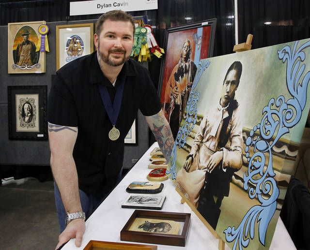 "Artist Dylan Cavin, of Norman, is shown with some of his art at his booth at the Red Earth Native American Cultural Festival in the Cox Convention Center.  The artwork at right,   titled, ""Ann,"" is acrylic on canvas.  Photo  by Jim Beckel, The Oklahoman"