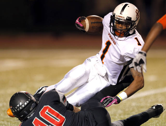 Putnam City's Marc Perry is brought down by Westmoore's Denver Beebe during the high school football game between Moore and Putnam City at Westmoore High School,  Thursday, Oct. 4, 2012. Photo by Sarah Phipps, The Oklahoman