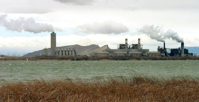 FILE - This April 6, 2006 file photo shows the Four Corners Power Plant, one of two coal-fired plants in northwest New Mexico, near Farmington, N.M. Owners of the 48-year-old plant, one of the nation's largest of its kind, are being sued by a coalition of environmental groups over allegations the plant has failed to install the best available equipment to control pollution. (AP Photo/Susan Montoya Bryan, File)