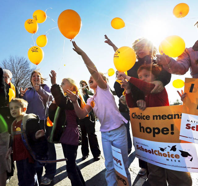 Students, parents and teachers release balloons at Sunnybrook Christian School as part of National School Choice Week. Photos by Nate Billings, The Oklahoman