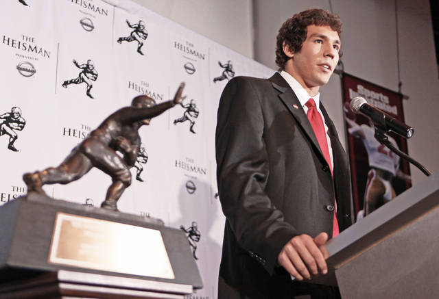 Winning the Heisman Trophy has gotten OU quarterback Sam Bradford a little more attention from the public. AP photo