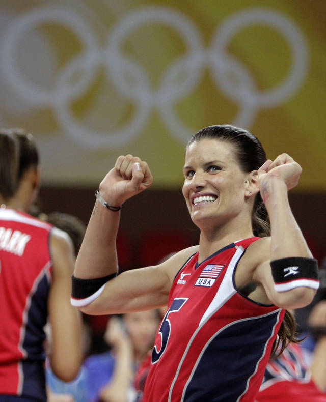 FILE - This Aug. 13, 2008, file photo shows USA's Stacy Sykora celebrating her team's win over Venezuela during their women's volleyball preliminary match at the Beijing 2008 Olympics in Beijing. Sykora believes that learning to compensate for the lingering effects of a brain injury has made her a better volleyball player. Whether she plays in a fourth Olympics is still in the air: The 12 team members will not be named until early July. (AP Photo/Andy Wong, File)