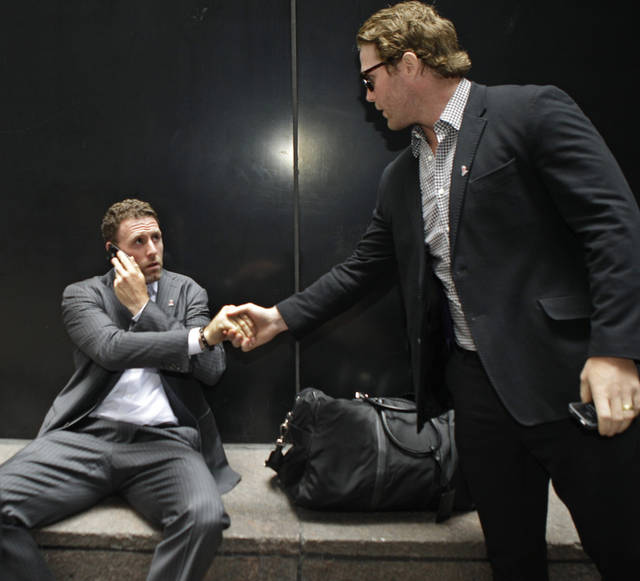 Detroit Red Wings Dan Cleary, right, shakes hands with Edmonton Oileers defenseman Ryan Whitney after they left the labor talks between the NHL Players Association and the league at the NHL's headquarters in New York, Tuesday, July 31, 2012. (AP Photo/Kathy Willens)