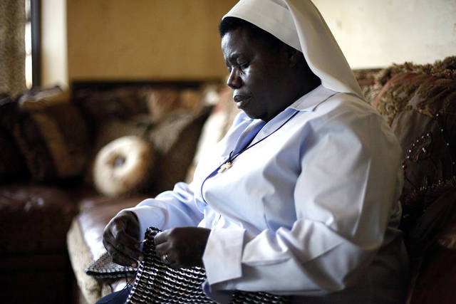 Sister Rosemary Nyriumbe sews pop-top purses at a home in Edmond, Okla., Tuesday, May 1, 2012. Photo by Sarah Phipps, The Oklahoman