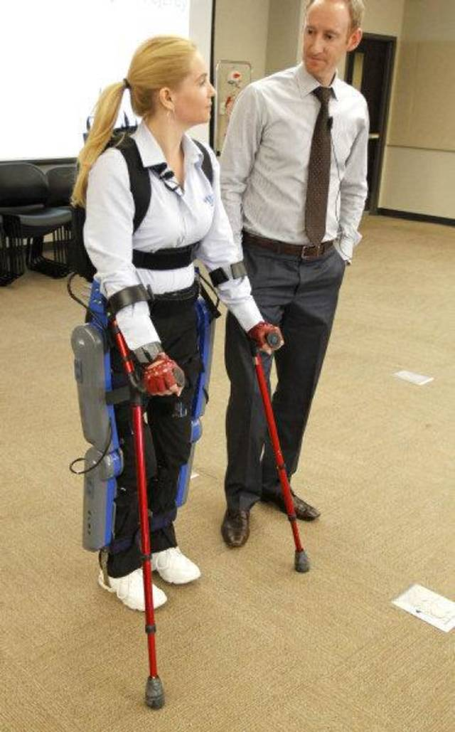 Agnes Fejerdy demonstrates the ReWalk gait system that returns mobility to spinal cord injury patients. Phil Astrachan, a physical therapist with Argo Medical Tehcnologies, stands nearby. <strong>PAUL HELLSTERN</strong>
