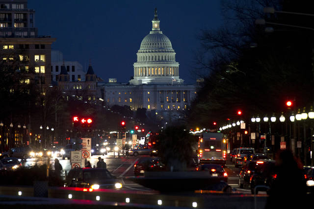 Red lights illuminate Pennsylvania Avenue as the U.S. Capitol glows in the twilight, in Washington, Wednesday, Dec. 19, 2012, as talks continue on the looming fiscal cliff. (AP Photo/Jacquelyn Martin)