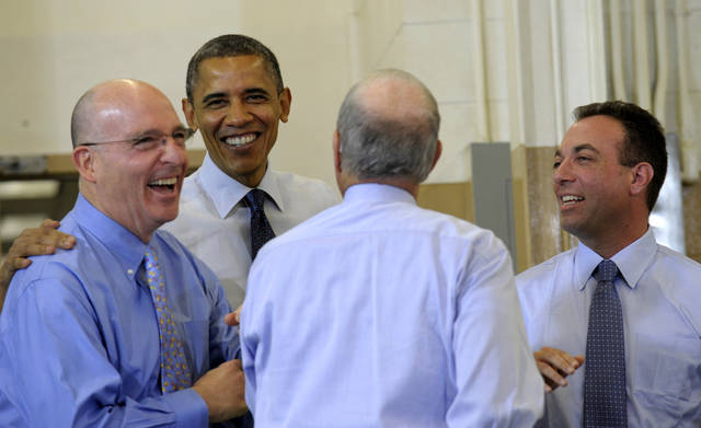 President Barack Obama talks with K'NEX Vice Chairman and General Counsel Robert Glickman, left, K'NEX Inventor and Chairman Joel Glickman, second from right, and Rodon Group President and Chief Executive Officer Michael Araten, right, during a tour of the company in Hatfield, Pa. Friday, Nov. 30, 2012. The visit comes as the White House continues a week of public outreach efforts, while also attempting to negotiate a deal with congressional leaders. The Rodon Group manufactures over 95% of the parts for K'NEX Brands toys. (AP Photo/Susan Walsh)