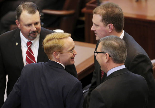 Mike Jackson, second from left, is congratulated by fellow House members after he was elected by his colleagues as the speaker pro tempore. T. W. Shannon was elected by his colleagues in the Oklahoma House of Representatives as their Speaker for the upcoming legislative session. Shannon, a Democrat from Lawton, is Oklahoma's first black Speaker of the House. He was sworn in on the floor of the House by Oklahoma Supreme Court Chief Justice Tom Colbert on Tuesday, Jan. 8, 2013.  Colbert became  Oklahoma's first black chief justice when he was sworn in last week.    Photo by Jim Beckel, The Oklahoman