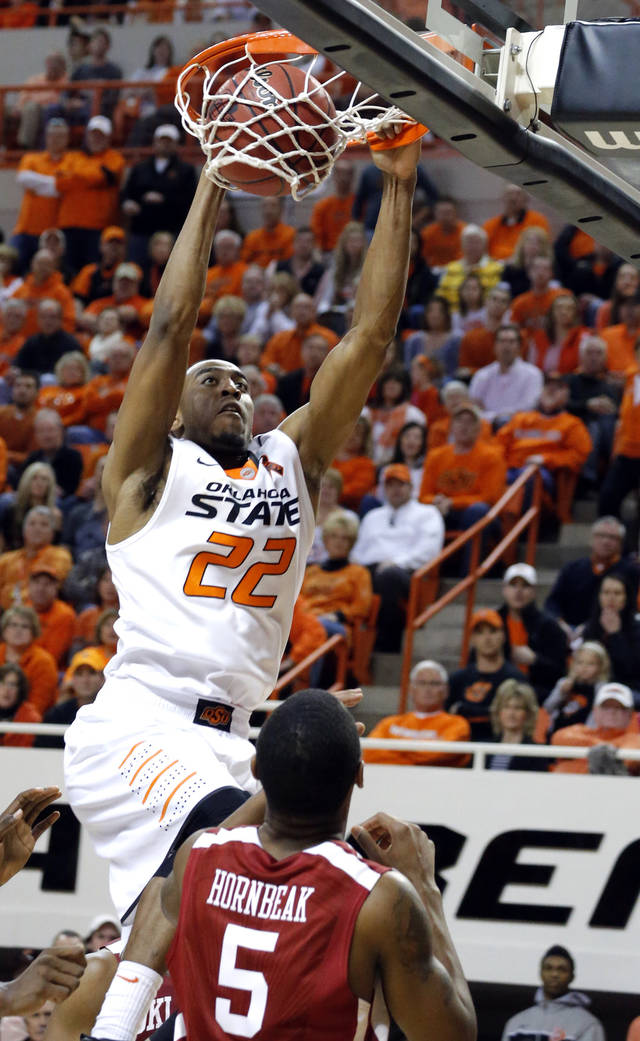 Oklahoma State's Markel Brown (22) dunks in front of Oklahoma's Je'lon Hornbeak (5) during the Bedlam men's college basketball game between the Oklahoma State University Cowboys and the University of Oklahoma Sooners at Gallagher-Iba Arena in Stillwater, Okla., Saturday, Feb. 16, 2013. Photo by Sarah Phipps, The Oklahoman