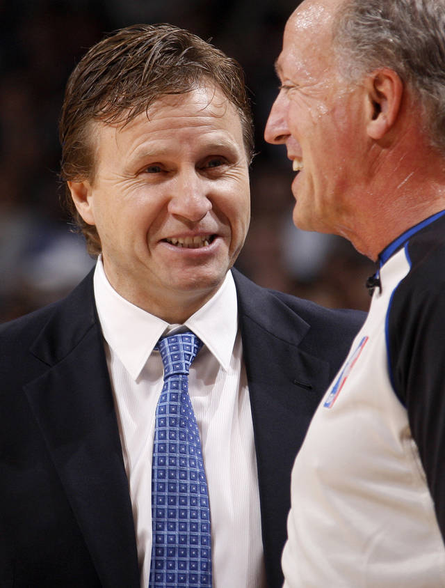 NBA BASKETBALL: Oklahoma CIty coach Scott Brooks talks with an official during a preseason NBA game between the Oklahoma City Thunder and the Dallas Mavericks at Chesapeake Energy Arena in Oklahoma City, Tuesday, Dec. 20, 2011. Photo by Bryan Terry, The Oklahoman